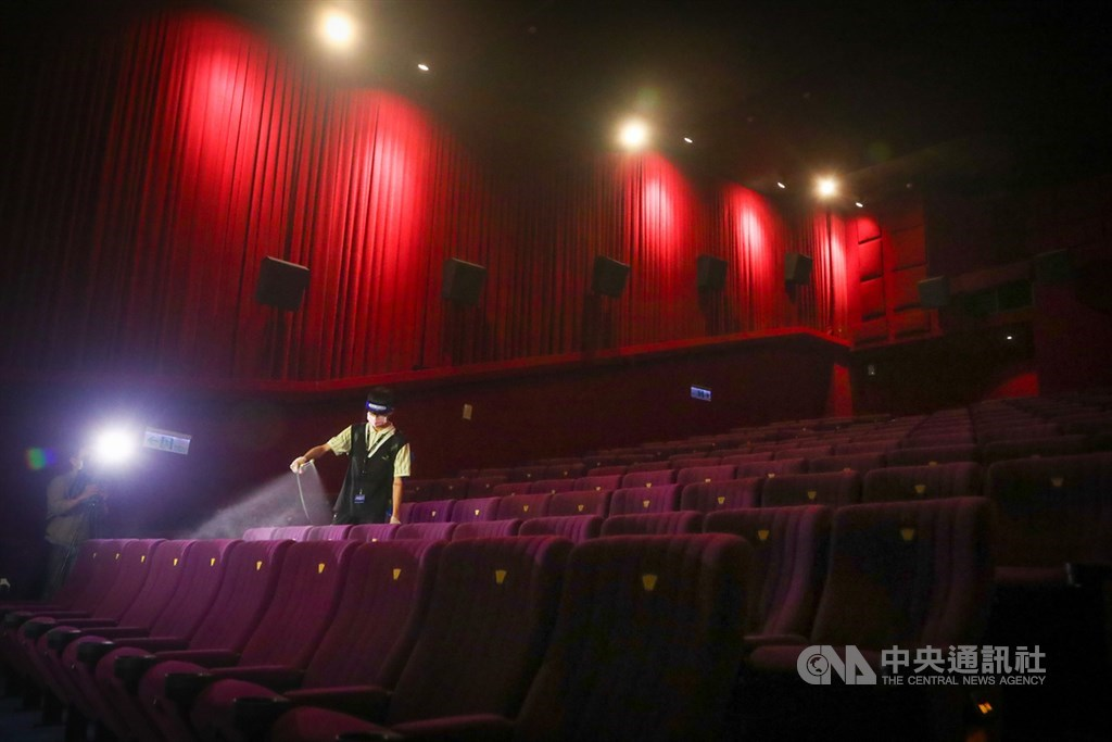 An employee at a movie theater in Taipei disinfects seats between showings. CNA file photo