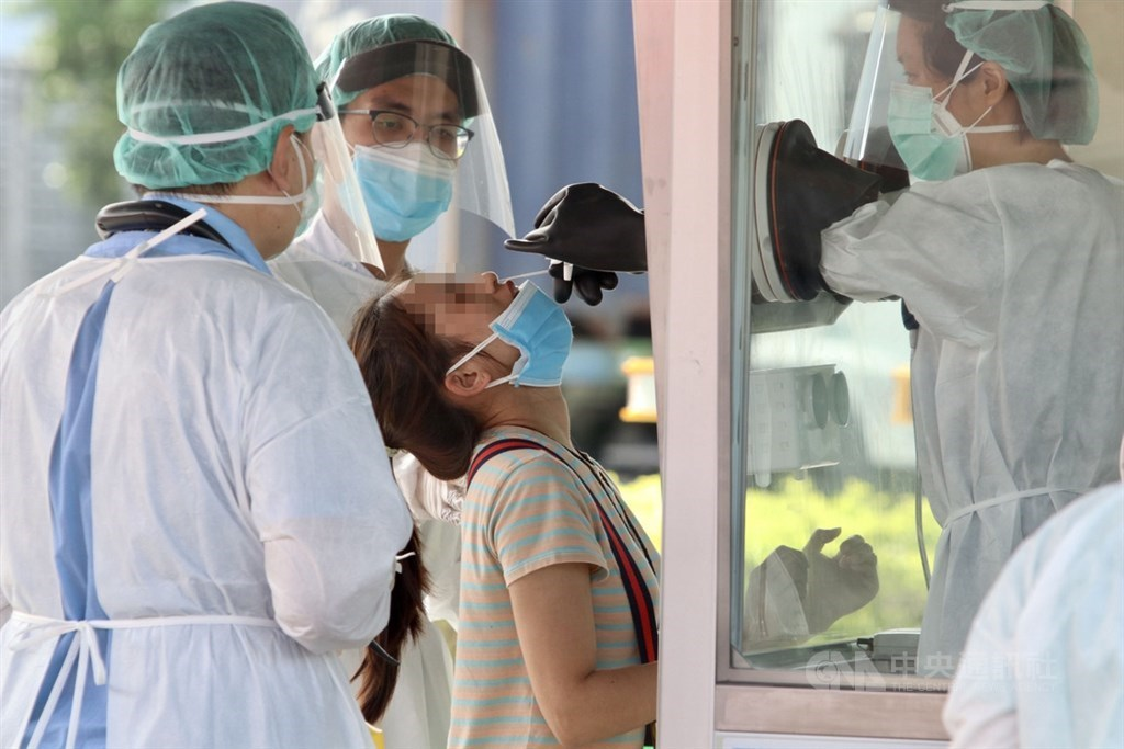 A migrant worker takes a COVID-19 test. CNA file photo