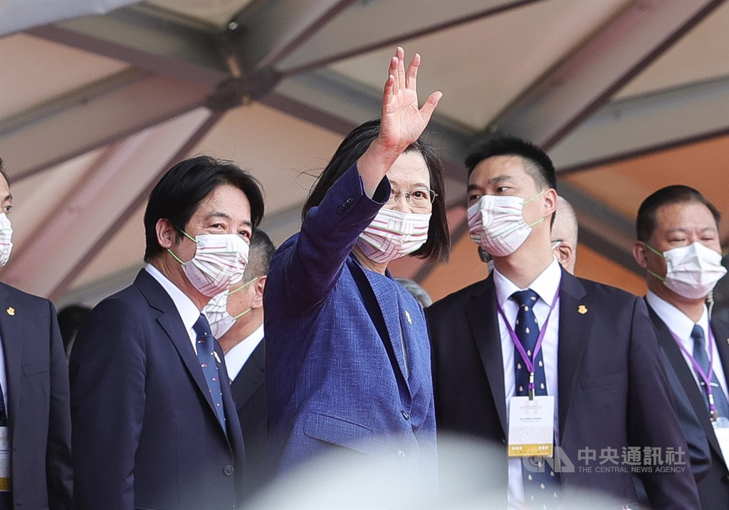 President Tsai Ing-wen (center) waves to the crowds at the end of Sunday morning