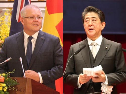 左からオーストラリアのモリソン首相、日本の安倍首相=資料写真