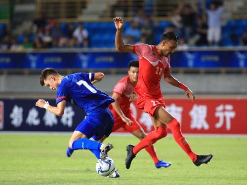 Taiwan midfielder Will Donkin (left) and Nepal midfielder Rohit Chand (right) / Photo courtesy of Chinese Taipei Football Association