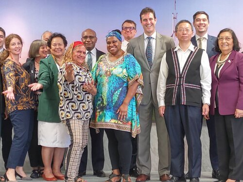 Joyce Bonner (first row, third left) and Leonora Adidi (first row, fourth left) take photo with other dignitaries the Australian Office in Taipei on Friday.