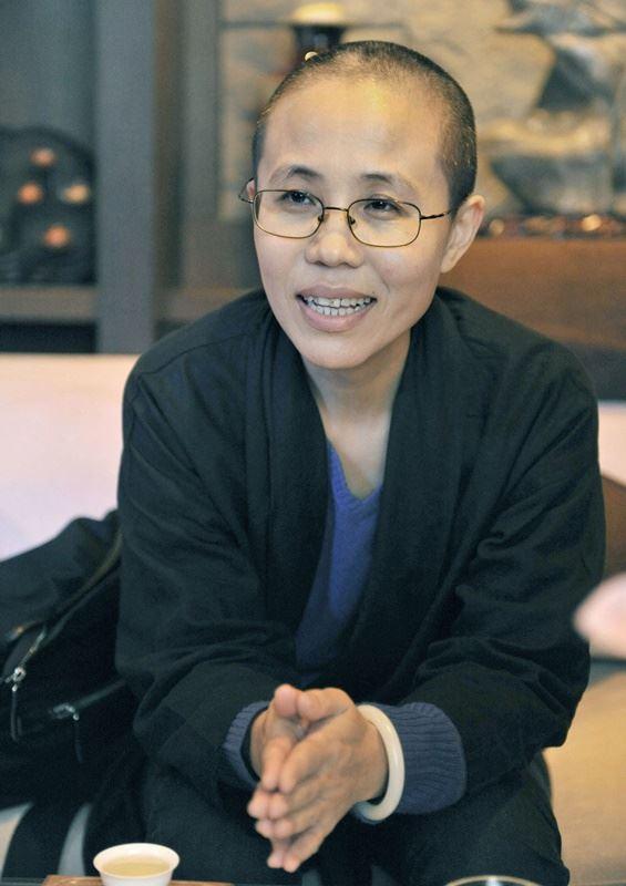 中國諾貝爾和平獎得主劉曉波的遺孀劉霞獲解除軟禁重獲自由後,搭機取道芬蘭到德國。(檔案照片/共同社提供)