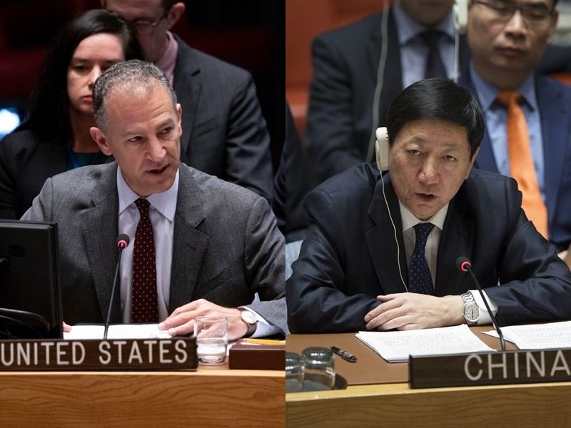 圖為美國駐聯合國代理大使柯恩(左)及中國駐聯合國副大使吳海濤(右)。(圖取自twitter.com/USUN;檔案照片/中新社提供)