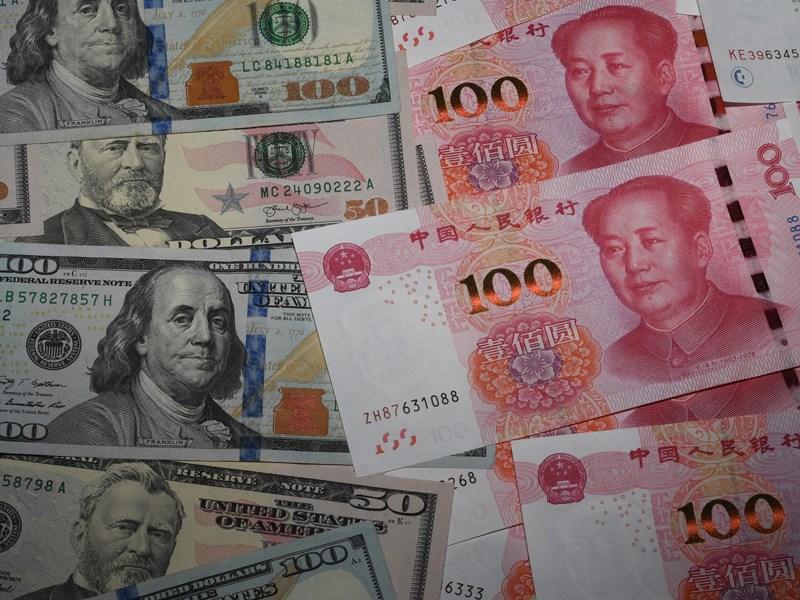 人民幣近期走弱,再次面臨「保7」關卡,但在美中談判桌上,華府的中國匯率政策始終是川普政府擺出的一道難題。(檔案照片/共同社提供)