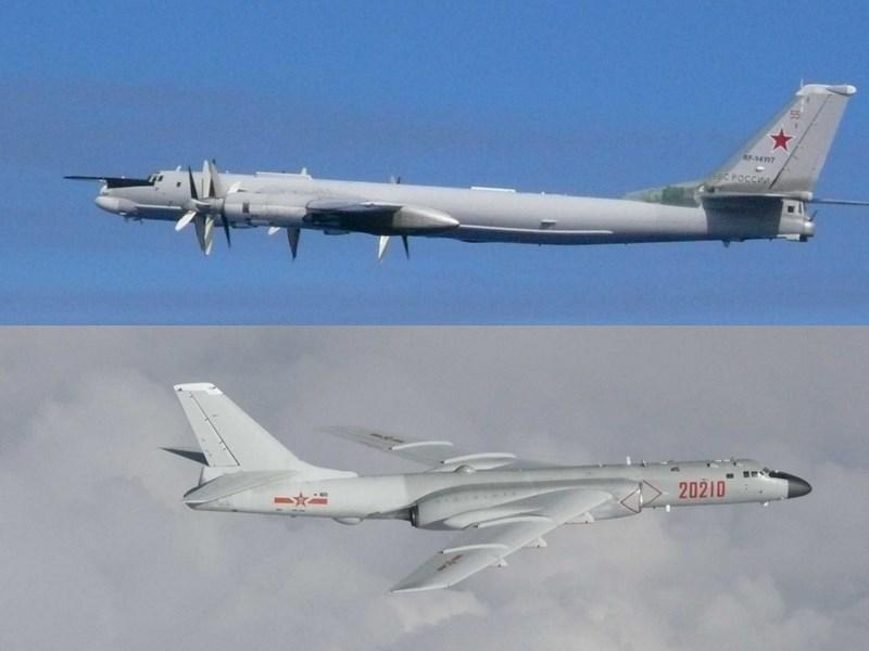 俄羅斯2架TU-95轟炸機(上)和中國2架H-6轟炸機(下)23日在南韓與日本外海的爭議區域空中巡邏,分析家指出,這是兩國意圖挑戰美國在亞太地區影響力的「重大進展」。(圖取自日本防衛省自衛隊網頁www.mod.go.jp)