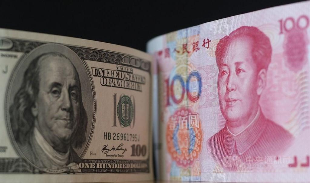 中國人民銀行放任人民幣貶破7元兌1美元關卡,川普政府正式認定中國為匯率操縱國,美中貿易戰又升溫進入貨幣戰。(中央社檔案照片)