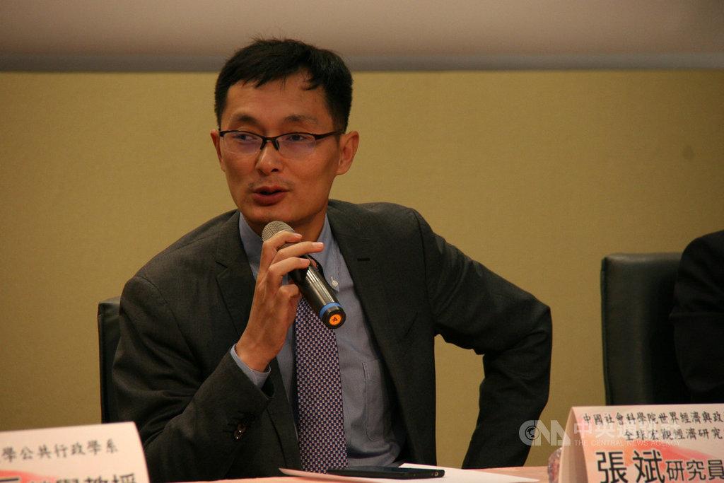 對於中國經濟結構轉型,中國社科院研究員張斌(圖)認為,如何提供成熟的公共服務政策,將是未來的長期施政目標。中央社記者繆宗翰攝 108年12月10日