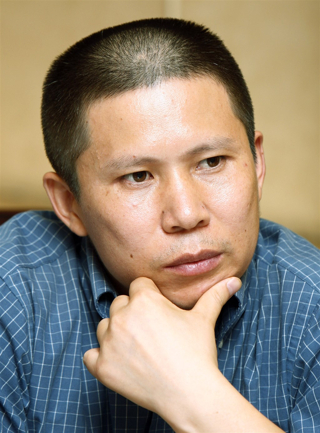 中國公民運動倡議者、日前因呼籲中國國家主席習近平讓位而遭追查的法學博士許志永(圖),據稱已於15日晚間在廣州被拘捕。(檔案照片/美聯社)