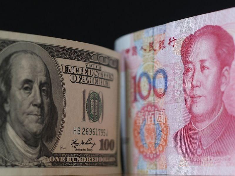 據中國外匯交易中心公布,人民幣兌美元匯率中間價10日報1美元兌人民幣6.9943元,創3月13日以來最高。(中央社檔案照片)