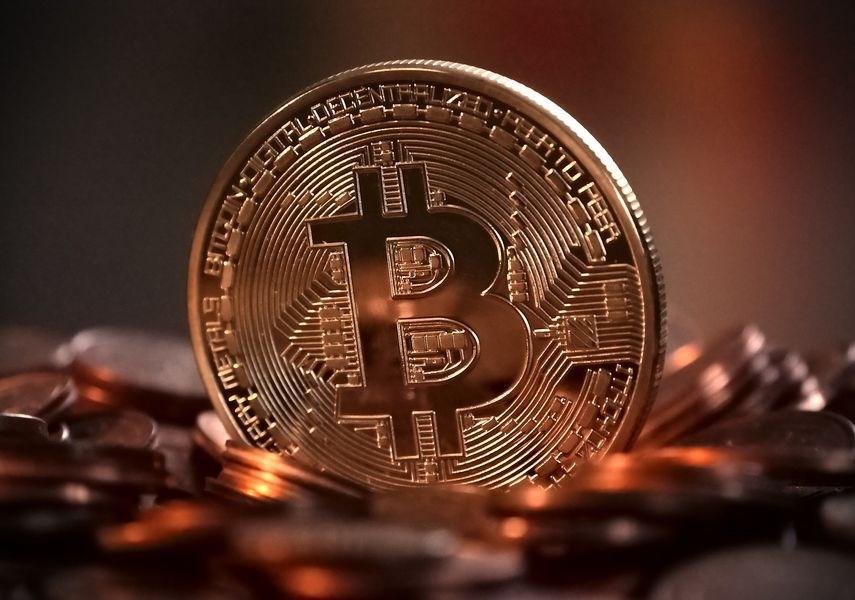 全球最受歡迎的加密貨幣比特幣19日價位再創新高。(圖取自Pixabay圖庫)