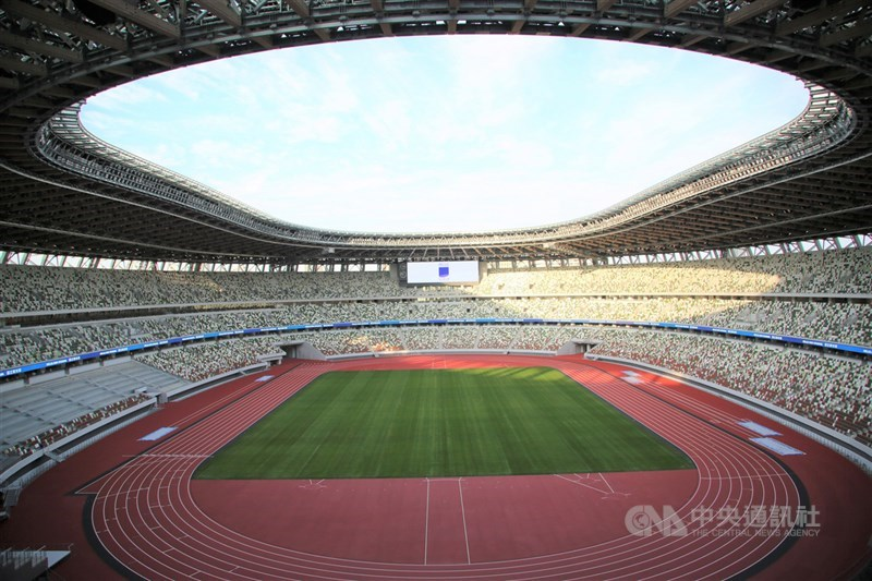 武漢肺炎疫情延燒,期盼東京奧運延後的聲浪四起。圖為2020年東京奧運暨帕運主場館國立競技場2019年12月15日舉行竣工典禮。(中央社檔案照片)