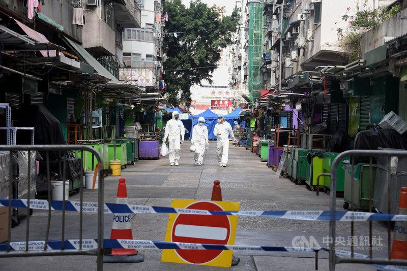 香港當局上週末因為武漢肺炎疫情圍封佐敦部分地區(圖),經過兩天強制檢疫,25日凌晨解封,共找到13名確診者。(中通社提供)