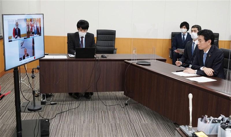 英國國際貿易大臣特拉斯1B日與日本經濟再生擔當大臣西村康稔等人舉行線上會談時表示,英國要申請加入CPTPP。(共同社)