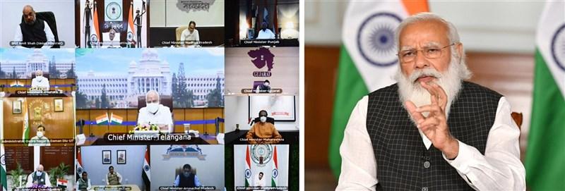 印度第二波武漢肺炎疫情持續惡化,莫迪 (右)8日晚與各省市首長召開視訊會議討論對策,他排除再度執行全國封鎖的可能,支持採宵禁與設立微型禁制區措施。(印度總理辦公室提供)中央社記者康世人新德里傳真 110年4月9日