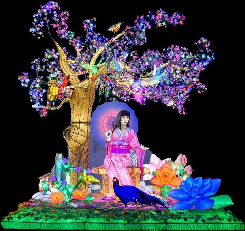 屏東監獄收容人今年打造的花燈作品「春曉」,是以櫻花樹為主體,呈現穿著日本傳統服裝女子撐傘坐在樹下,腳邊有孔雀及鮮豔花朵,樹上則有各色鳥類,五彩繽紛,讓看到的人都會說「美翻了!」(屏東監獄提供)中央社記者郭芷瑄傳真 110年4月22日