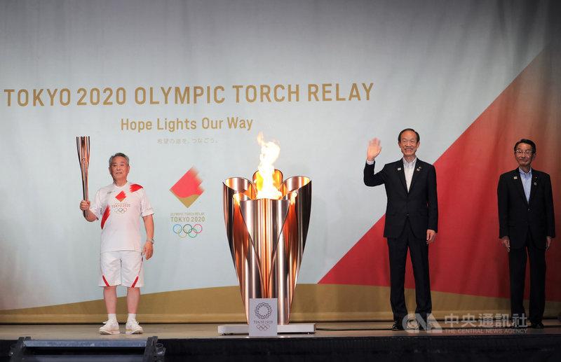 東京奧運23日晚間舉行開幕式。聖火傳遞22日晚上來到東京都港區,23日上午將在終點站東京都廳舉辦聖火抵達儀式,晚上在東奧開幕式點燃聖火台。中央社記者楊明珠東京攝 110年7月23日