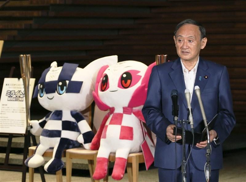 日本首相兼自民黨總裁菅義偉9月3日宣布不參選黨總裁,震驚政壇。日媒報導,日本有個舉辦奧運的那年首相就會換人的「魔咒」,菅義偉也沒能打破。(共同社)